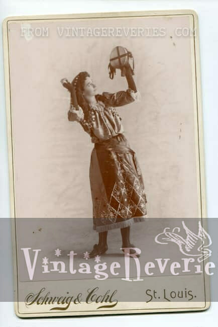 1800s girl with a tambourine
