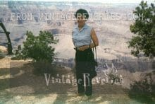 1960s woman in slacks next to the grand canyon