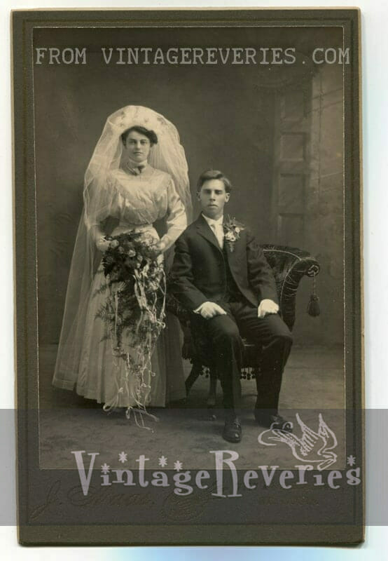 Edwardian era wedding gown and bouquet with groom