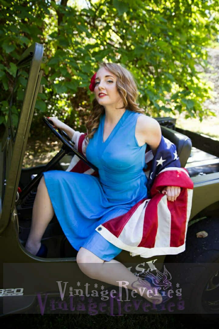 pinup model in a willys jeep