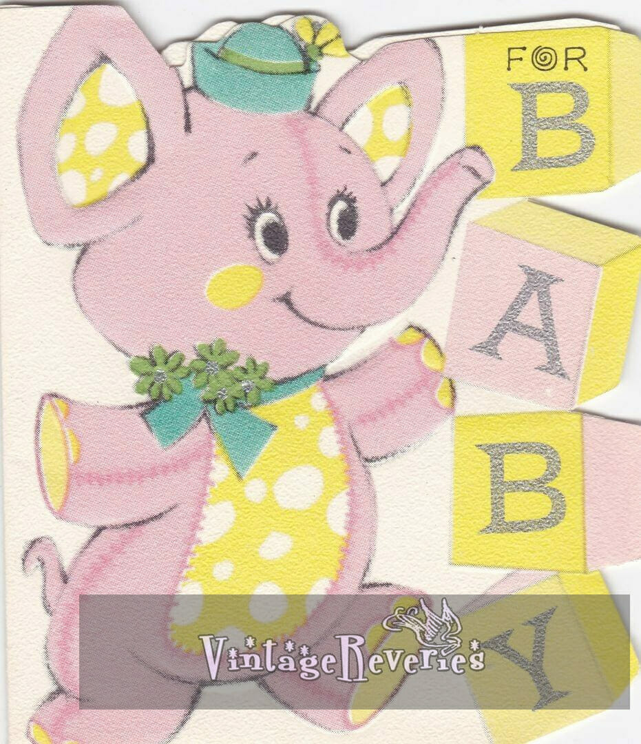 pink stuffed elephant with BABY spelled out in blocks