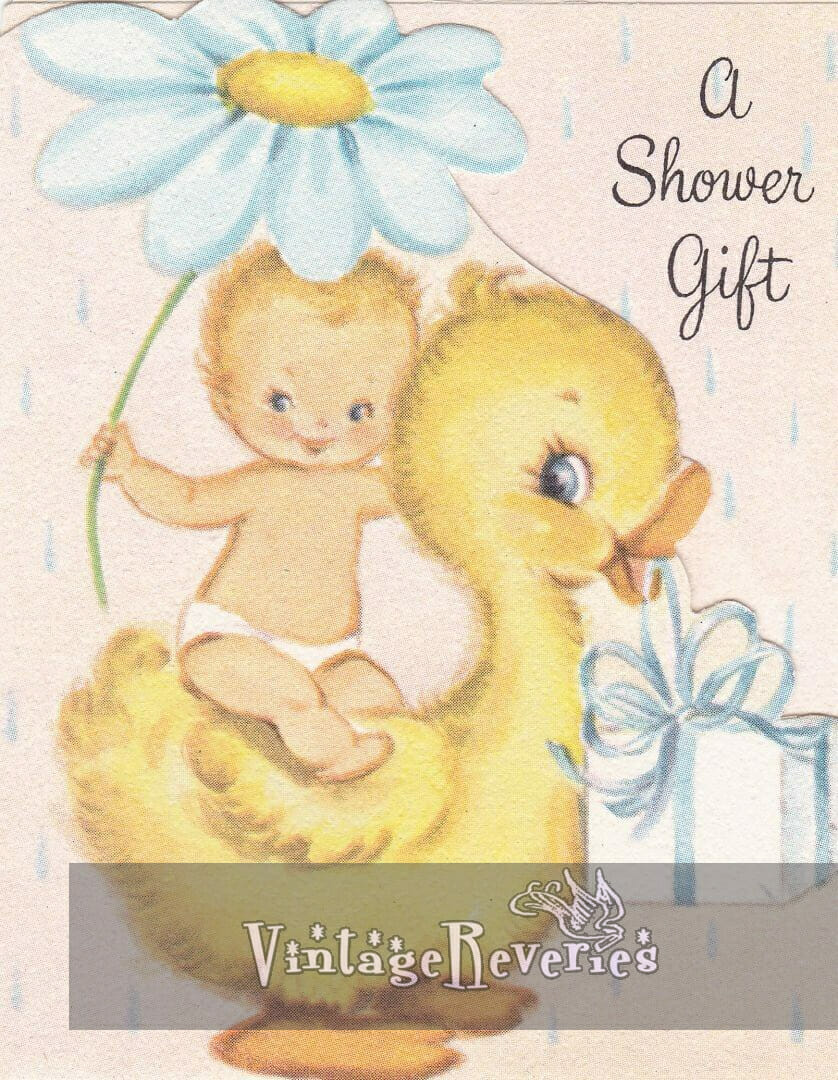 baby riding a yellow duck