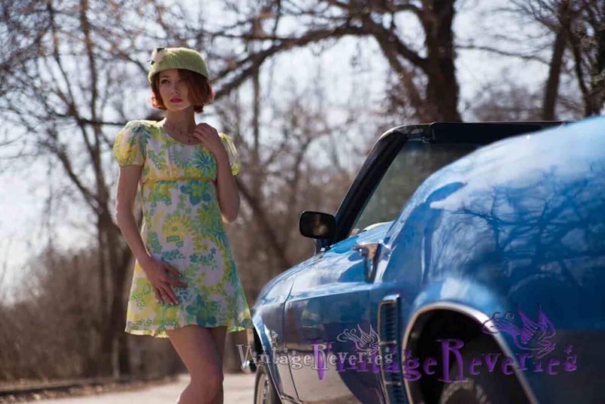 green 1960s mini dress and blue car