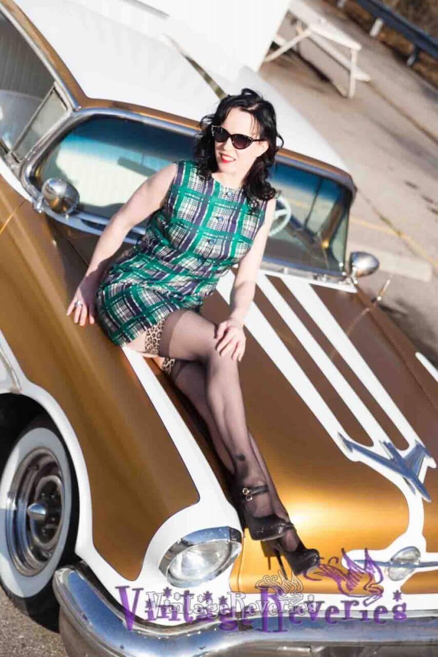 long legged model on a car