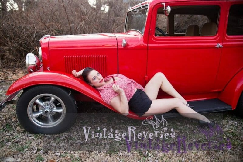 reclining on a vintage car