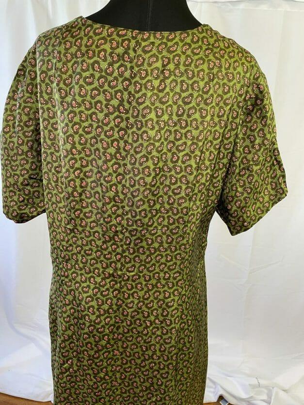 rear back of green vintage dress