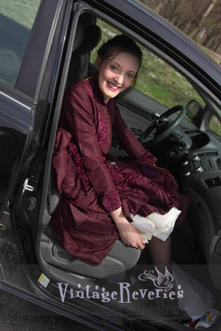1800s dress snapshot in a car